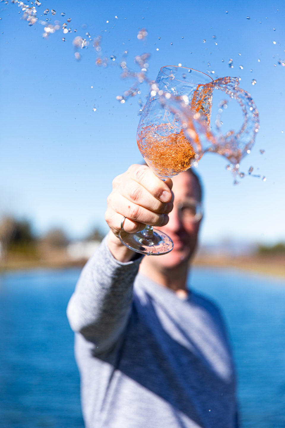 Man Splashing Rosé Wine